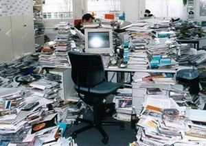 This stock photo reassures me no end; my office will NEVER look like this. Honest.