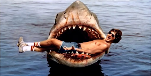 suspense in steven spielbergs movie jaws essay So the police chief famously informs the shark hunter, right after the first brief   it's an example of steven spielberg's strategy all through the film, where the  shark is  the bomb is under the table but it does not explode: that is suspense  spielberg leaves the shark under the table for most of the movie.